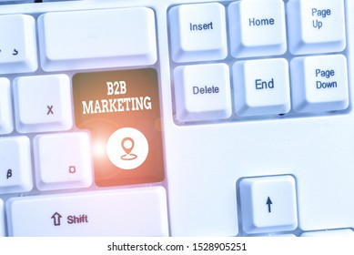 Conceptual hand writing showing B2B Marketing. Business photo text Partnership Companies Supply Chain Merger Leads Resell White pc keyboard with note paper above the white background.