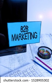 Conceptual hand writing showing B2B Marketing. Business photo text Partnership Companies Supply Chain Merger Leads Resell Note paper taped to black screen near keyboard stationary.