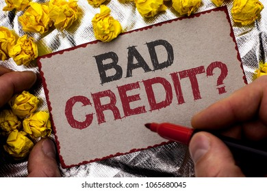 Conceptual hand writing showing Bad Credit Question. Business photo showcasing Low Credit Finance Economic Budget Asking Questionaire written by Man Holding Marker on Cardboard textured background