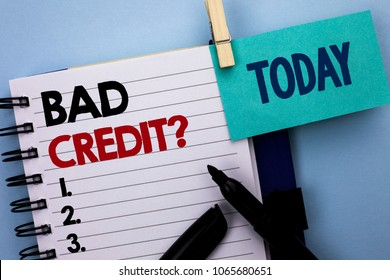 Conceptual hand writing showing Bad Credit Question. Business photo text Low Credit Finance Economic Budget Asking Questionaire written on Notebook Book on plain background Today Marker next to it