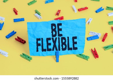 Conceptual hand writing showing Be Flexible. Business photo showcasing able to be easily modified to respond to altered circumstances Colored clothespin papers empty reminder yellow floor office.