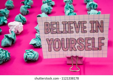 Conceptual hand writing showing Believe In Yourself. Business photo showcasing Determination Positivity Courage Trust Faith Belief Paperclip with pink letters pink ground green paper lobs.