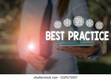 Conceptual hand writing showing Best Practice. Business photo showcasing Method Systematic Touchstone Guidelines Framework Ethic Woman wear work suit presenting presentation smart device.