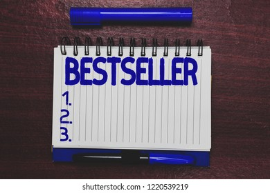 Conceptual hand writing showing Bestseller. Business photo text Book product sold in large numbers Successful literature Open notebook page marker communicating ideas wooden background.