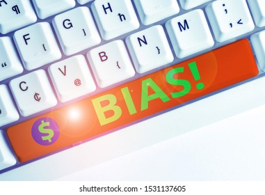 Conceptual hand writing showing Bias. Business photo text inclination or prejudice for or against one demonstrating group White pc keyboard with note paper above the white background.