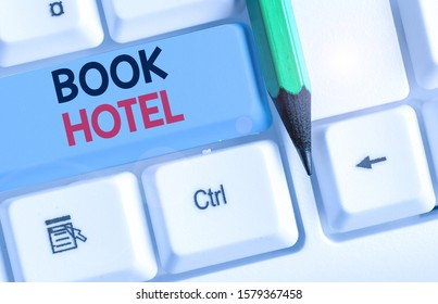 Conceptual hand writing showing Book Hotel. Business photo text an arrangement you make to have a hotel room or accommodation.