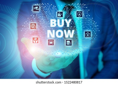 Conceptual hand writing showing Buy Now. Business photo showcasing asking someone to purchase your product Provide good Discount Male wear formal suit presenting presentation smart device.