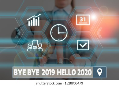Conceptual hand writing showing Bye Bye 2019 Hello 2020. Business photo showcasing Starting new year Motivational message 2019 is over Woman wear work suit presenting presentation smart device.