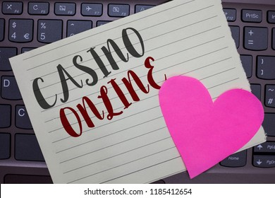 Conceptual hand writing showing Casino Online. Business photo showcasing Computer Poker Game Gamble Royal Bet Lotto High Stakes Notebook paper keyboard Romantic Lovely ideas Type computer.