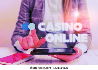Conceptual hand writing showing Casino Online. Business photo showcasing Computer Poker Game Gamble Royal Bet Lotto High Stakes Business concept with communication mobile phone.