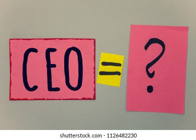 Conceptual hand writing showing Ceo. Business photo text Chief Executive Officer Head Boss Chairperson Chairman Controller Paper equal sign question marks beige background doubt message.