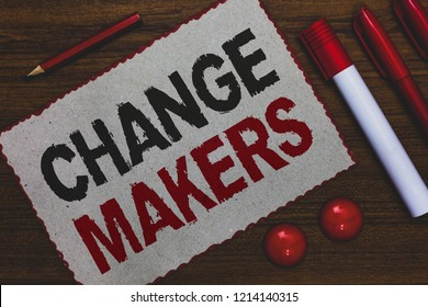 Conceptual hand writing showing Change Makers. Business photo showcasing Young Turk Influencers Acitivists Urbanization Fashion Gen X White paper red borders markers pencils wooden background.