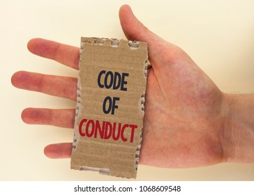 Conceptual hand writing showing Code Of Conduct. Business photo text Follow principles and standards for business integrity written Tear Cardboard Piece the plain background Hand.