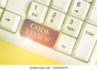 Conceptual hand writing showing Code Review. Business photo showcasing single most effective technique for identifying security flaws White pc keyboard with note paper above the white background.