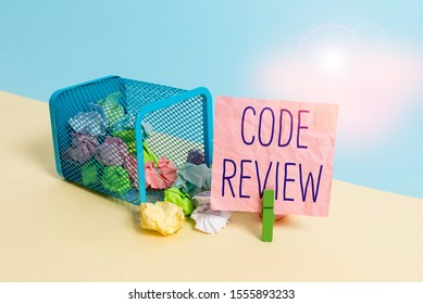 Conceptual hand writing showing Code Review. Business photo text single most effective technique for identifying security flaws Trash bin crumpled paper clothespin reminder office supplies.
