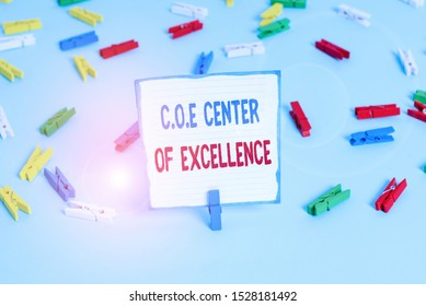 Conceptual hand writing showing Coe Center Of Excellence. Business photo text being alpha leader in your position Achieve Colored clothespin papers empty reminder blue floor officepin.