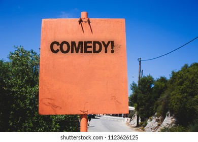 Conceptual hand writing showing Comedy Call. Business photo text Fun Humor Satire Sitcom Hilarity Joking Entertainment Laughing Wooden board post ideas blue sky trees antique vintage landscape.