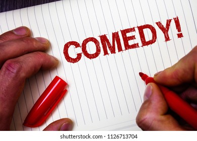 Conceptual hand writing showing Comedy Call. Business photo showcasing Fun Humor Satire Sitcom Hilarity Joking Entertainment Laughing Man hold holding marker paper thoughts messages intentions.