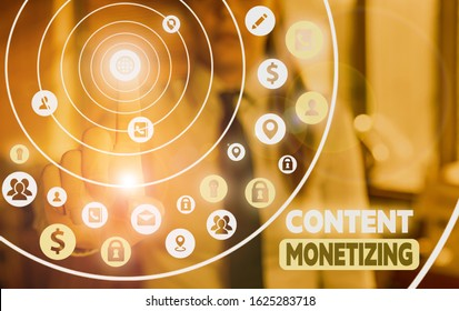 Conceptual hand writing showing Content Monetizing. Business photo showcasing making money from content that exists on your website.