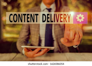 Conceptual hand writing showing Content Delivery. Business photo showcasing geographically distributed network of proxy servers Female business person sitting by table holding mobile phone.