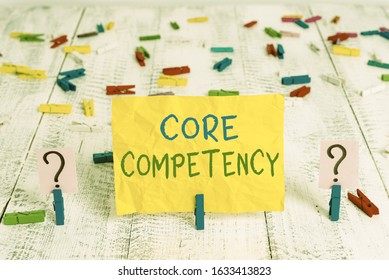 Conceptual hand writing showing Core Competency. Business photo text harmonized combination of multiple resources and skills Crumbling sheet with paper clips placed on the wooden table.
