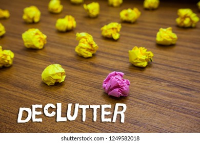Conceptual hand writing showing Declutter. Business photo showcasing remove unnecessary items from untidy or overcrowded place Lots crumpled papers mistakes not satisfied wooden floor.