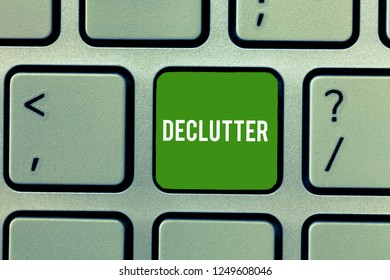 Conceptual hand writing showing Declutter. Business photo showcasing remove unnecessary items from untidy or overcrowded place Keyboard Intention to create computer message keypad idea.