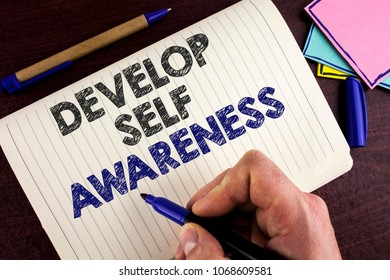 Conceptual hand writing showing Develop Self Awareness. Business photo showcasing What you think you become motivate and grow written by Man Notebook Book wooden background Pen.