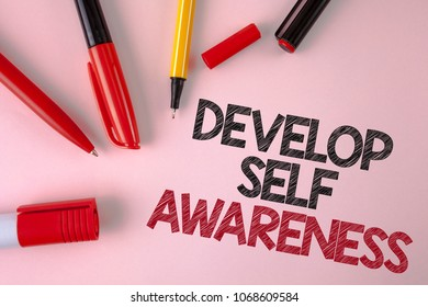 Conceptual hand writing showing Develop Self Awareness. Business photo text What you think you become motivate and grow written plain Pink background Pens and Marker next to it.