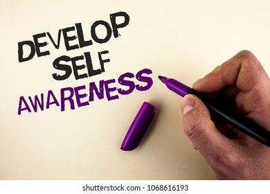 Conceptual hand writing showing Develop Self Awareness. Business photo showcasing What you think you become motivate and grow written by Man plain background holding Marker in Hand.