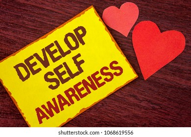 Conceptual hand writing showing Develop Self Awareness. Business photo text What you think you become motivate and grow written Yellow Sticky note paper wooden background Hearts.