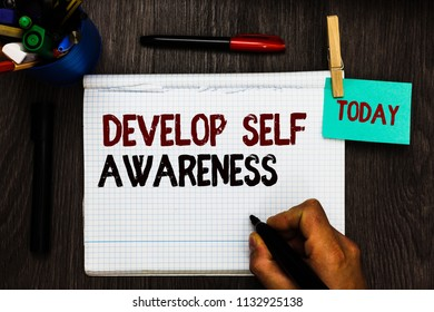 Conceptual hand writing showing Develop Self Awareness. Business photo text increase conscious knowledge of own character Register pages handwriting text work stationery items woody table.