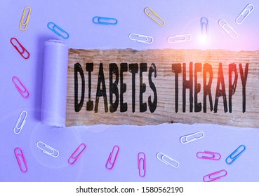 Conceptual hand writing showing Diabetes Therapy. Business photo showcasing aim to achieve lower average blood glucose results Paper clip and torn cardboard on wood classic table backdrop.