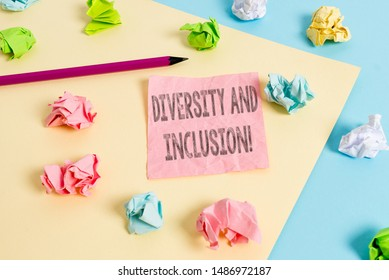 Conceptual hand writing showing Diversity And Inclusion. Business photo text range huanalysis difference includes race ethnicity gender Colored crumpled papers empty reminder blue yellow clothespin.
