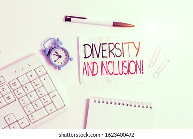 Conceptual hand writing showing Diversity And Inclusion. Business photo showcasing range huanalysis difference includes race ethnicity gender Copy space on note paper with clock and pencil on the
