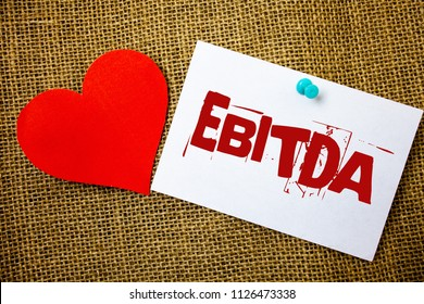 Conceptual hand writing showing Ebitda. Business photo text Earnings Before Interest Taxes Depreciation Amortization Abbreviation Message note jute background red heart letters love grunge idea.
