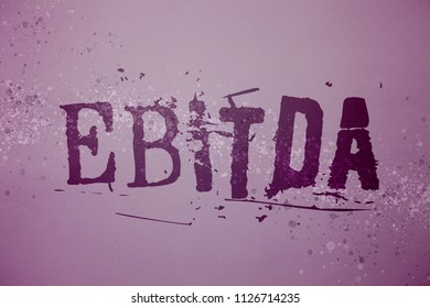 Conceptual hand writing showing Ebitda. Business photo text Earnings Before Interest Taxes Depreciation Amortization Abbreviation Ideas messages purple background splatters inspiration communicate.