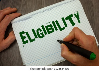Conceptual hand writing showing Eligibility. Business photo text State of having the right for doing or obtain something Proper Man hold holding black marker gruge notebook wooden wood table.