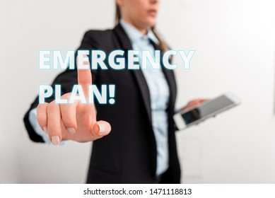 Conceptual hand writing showing Emergency Plan. Business photo text actions developed to mitigate damage of potential events Digital business in black suite concept with business woman.
