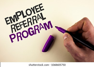 Conceptual hand writing showing Employee Referral Program. Business photo showcasing Recommend right jobseeker share vacant job post written by Man plain background holding Marker in Hand.