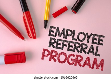 Conceptual hand writing showing Employee Referral Program. Business photo text Recommend right jobseeker share vacant job post written plain Pink background Pens and Marker next to it.