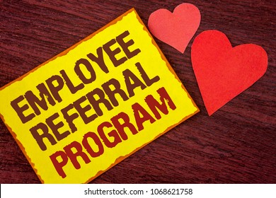 Conceptual hand writing showing Employee Referral Program. Business photo text Recommend right jobseeker share vacant job post written Yellow Sticky note paper wooden background Hearts.