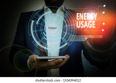 Conceptual hand writing showing Energy Usage. Business photo showcasing Amount of energy consumed or used in a process or system Male wear formal suit presenting presentation smart device.