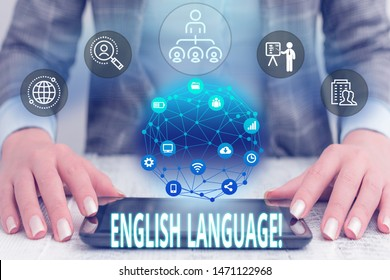 Conceptual hand writing showing English Language. Business photo text third spoken native lang in world after Chinese and Spanish Female human wear formal work suit presenting smart device.