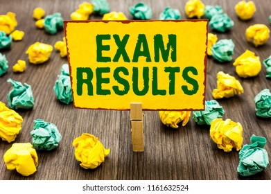 Conceptual hand writing showing Exam Results. Business photo text An outcome of a formal test that shows knowledge or ability Clothespin holding yellow note paper crumpled papers mistakes.