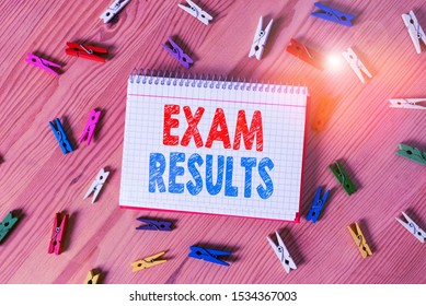 Conceptual hand writing showing Exam Results. Business photo text An outcome of a formal test that shows knowledge or ability Colored crumpled papers wooden floor background clothespin.