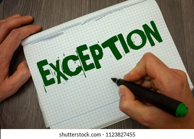 Conceptual hand writing showing Exception. Business photo text Person or thing that is excluded from general statement Different Man hold holding black marker gruge notebook wooden wood table.