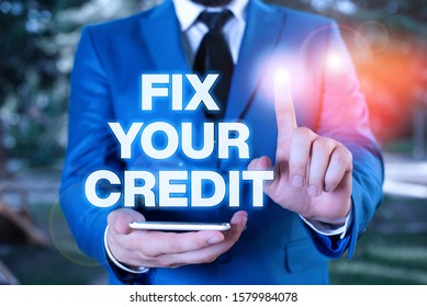 Conceptual hand writing showing Fix Your Credit. Business photo showcasing Keep balances low on credit cards and other credit Businessman with pointing finger in front of him.