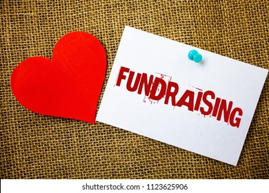 Conceptual hand writing showing Fundraising. Business photo text Seeking of financial support for charity cause or enterprise Message note jute background red heart letters love grunge idea.