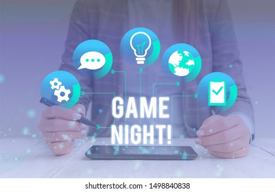 Conceptual hand writing showing Game Night. Business photo showcasing usually its called on adult play dates like poker with friends Female human wear formal work suit presenting smart device.